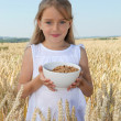 Little girl holding bowl of cereals — Stock Photo