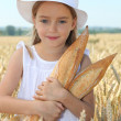 Little girl holding bread — Stock Photo