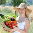 Stock Photo: Beautiful womwith basket of vegetables