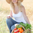 Beautiful woman with basket of vegetables — Stock Photo