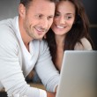Couple with laptop computer — Stock Photo #6703582