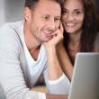 Couple with laptop computer — Stock Photo #6703585