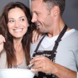Couple having fun cooking - Stok fotoraf