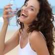 Beautiful woman drinking water - Stock Photo