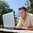 Man with laptop on a pontoon — Stock Photo #6704011