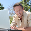 Man with laptop on a pontoon — Stock Photo #6704014