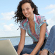 Woman with laptop on a pontoon — Stok fotoğraf