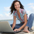 Woman using laptop computer — Stock Photo