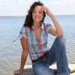 Stock Photo: Womsitting on pontoon by lake