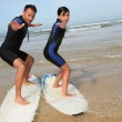 Father and daughter surfing — Stock Photo