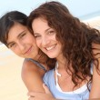 Mother and daughter at the beach — Stock Photo