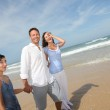 Family walking by the beach — Stock Photo #6704174
