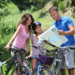 Stock Photo: Family on a bicycle ride