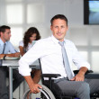 Stock Photo: Businessmin wheelchair