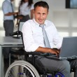 Businessman in wheelchair — Stock Photo #6704848