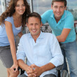 Group of office workers with handicapped person — Stock Photo #6704906