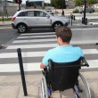 Young man using wheelchair - Stock Photo