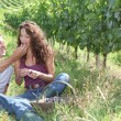 Stok fotoğraf: Couple of winegrowers eating grapes