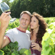 Couple of winegrowers in vineyard — Stock Photo