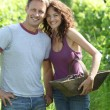 Happy couple standing in vineyard — Stock Photo