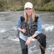 Stock Photo: Woman fly-fishing