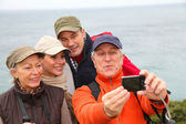 Group of hikers taking picture of themselves — Stock Photo