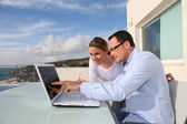 Couple using laptop computer — Stock Photo