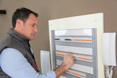 Electrician checking switchboard — Stock Photo