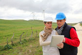 Engineers working with electronic tablet — Stock Photo