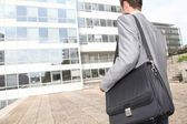 Businessman standing outside the office — Stock Photo