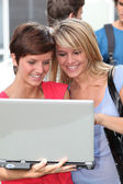 Students at college campus with laptop computer — Stock Photo