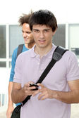 Young man with mobile phone — Stockfoto