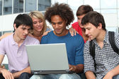 Group of student with laptop computer — Stock Photo