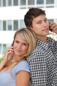 Young couple of students with mobile phone — Stock Photo