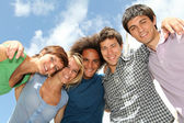 Group of happy students during summer break — Stock Photo