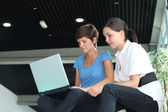 Young women working on laptop computer — Stock Photo