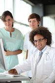 Doctor and nurses in a meeting — Stock Photo