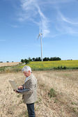 Agronomist in wheat field — Stock Photo