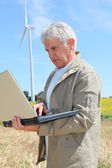 Agronomist in wheat field — Stock Photo