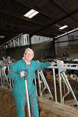 Breeder standing in barn — Stock Photo