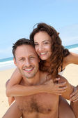 Happy couple at the beach — Foto Stock