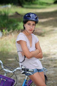 Girl sitting on a bicycle — Stock Photo