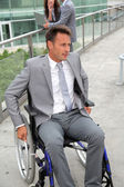 Businessman in wheelchair — Stock Photo