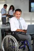 Businessman in wheelchair — Stock Photo