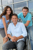 Group of office workers with handicapped person — Stock Photo