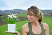 Beautiful woman in natural field — Stock Photo