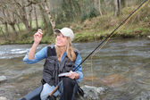 Woman fly-fishing — Stok fotoğraf