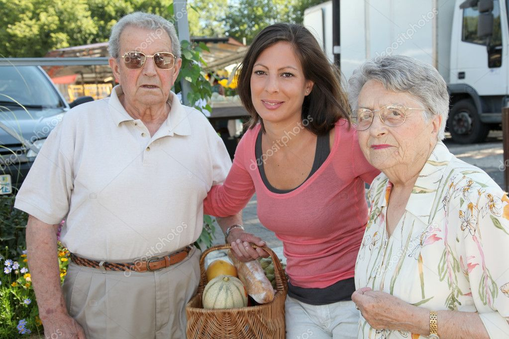 Closeup of young woman with couple of elderly persons — Stock Photo #6702811