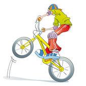 Boy practicing bike pirouettes — Stock Photo