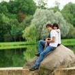 Young couple at park — Stock Photo